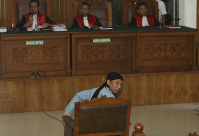 Radical Islamic cleric Aman Abdurrahman sits at the court room for his sentence hearing at South Jakarta District Court in Jakarta, Indonesia, on June 22, 2018. (AP Photo/Tatan Syuflana)