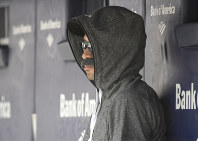 Ichiro Suzuki, special assistant to the chairman of the Seattle Mariners, wears a fake mustache and a hoodie as he sits in the dugout and watches the New York Yankees bat during the first inning of a baseball game, on June 21, 2018, at Yankee Stadium in New York. (AP Photo/Bill Kostroun)
