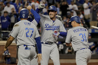 Los Angeles Dodgers' Cody Bellinger, center, celebrates with teammates after hitting a grand slam against the New York Mets during the sixth inning of a baseball game, on June 22, 2018, in New York. (AP Photo/Julie Jacobson)