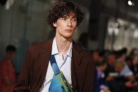 A model wears a creation as part of Hermes Men's Spring-Summer 2019 fashion collection presented in Paris, Saturday June 23, 2018. (AP Photo/Christophe Ena)