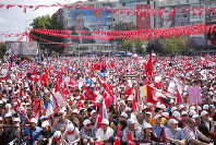 Supporters of Muharrem Ince, presidential candidate of Turkey's main opposition Republican People's Party, wave flags and posters of him during an election rally in Ankara, Turkey, Friday, June 22, 2018. Turkey holds parliamentary and presidential elections on June 24, deemed important as it will transform Turkey's governing system to an executive presidency. (AP Photo/Burhan Ozbilici)