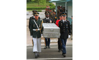 In this May 14, 1999 file photo, U.N. honor guards carry a coffin containing the remains of American soldiers after it was returned from North Korea at the border village of Panmunjom, South Korea. (AP Photo/Ahn Young-joon, File)