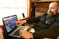 Daniel Burnside, a neo-Nazi leader, explains how to manage an internet radio program at his home in Potter County, Pennsylvania, in the eastern United States, on April 19, 2018. (Mainichi)
