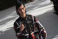 A model wears a creation as part of Dior Men's Spring-Summer 2019 fashion collection presented in Paris, on June 23, 2018. (AP Photo/Christophe Ena)