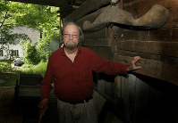 In this June 13, 2006, file photo, Donald Hall, author of numerous poetry books, poses in the barn of the 200-year-old Wilmot farm that has been in his family for four generations. (AP Photo/Jim Cole)