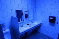In this June 22, 2018 photo, a public bathroom bathed in blue light is seen at this Turkey Hill convenience store in Wilkes-Barre, Pa. (AP Photo/Michael Rubinkam)