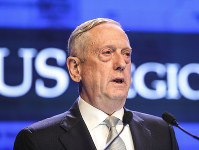 In this June 2, 2018 file photo, U.S. Defense Secretary Jim Mattis delivers his speech during the first plenary session of the 17th International Institute for Strategic Studies (IISS) Shangri-la Dialogue, an annual defense and security forum in Asia, in Singapore. (AP Photo/Yong Teck Lim)