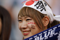 A Japan fan supports her team prior to the start of the group H match between Japan and Senegal at the 2018 soccer World Cup at the Yekaterinburg Arena in Yekaterinburg , Russia, Sunday, June 24, 2018. (AP Photo/Natacha Pisarenko)