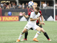 Portland Timbers midfielder Diego Valeri (8) is defended by Atlanta United defender Jeff Larentowicz (18) in the second half of an MLS soccer match, on June 24, 2018, in Atlanta, Ga. The match ended in a 1-1 draw. (AP Photo/Brett Davis)