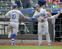 Los Angeles Dodgers' Justin Turner, left, is greeted by Max Muncy after hitting a solo home run during the 11th inning of a baseball game against the New York Mets at Citi Field, on June 24, 2018, in New York. (AP Photo/Seth Wenig)