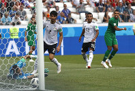 Saudi Arabia's Salem Aldawsari, right, scores his side's second goal during the group A match between Saudi Arabia and Egypt at the 2018 soccer World Cup at the Volgograd Arena in Volgograd, Russia, Monday, June 25, 2018. (AP Photo/Darko Vojinovic)