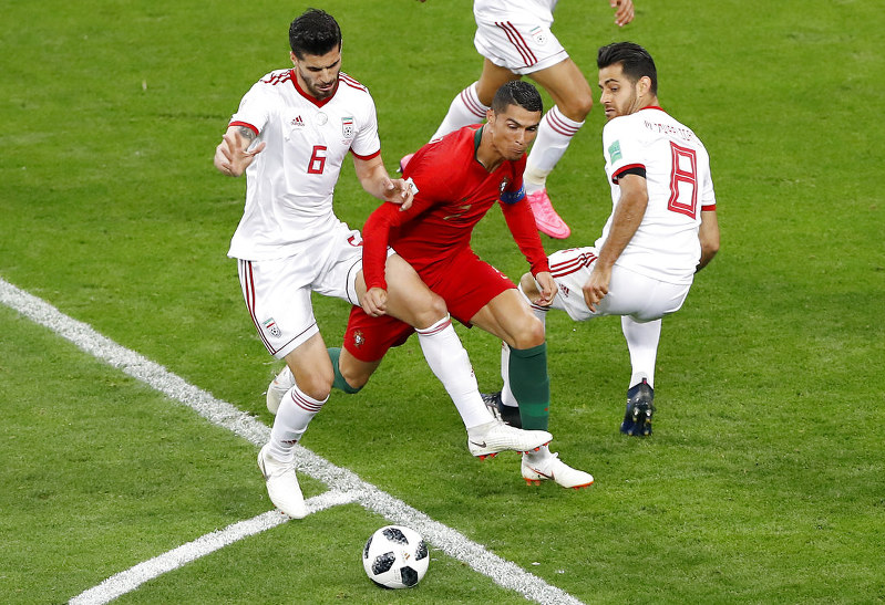 Image result for Cristiano Ronaldo misses penalty as Portugal fights off Iran to advance in FIFA World Cup