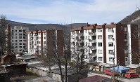 An apartment building where the biological father of Alen Muhic is said to have lived in Miljevina in southeastern Bosnia and Herzegovina is shown in this picture taken on March 10, 2018. (Mainichi)