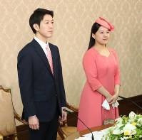 Princess Ayako, right, the youngest daughter of Emperor Akihito's late cousin Prince Takamado and her finance Kei Moriya, an employee at major shipping firm Nippon Yusen Kabushiki Kaisha, attend a news conference at the Imperial Household Agency in Tokyo's Chiyoda Ward, on July 2, 2018. (Pool photo)