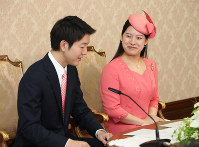 Princess Ayako, right, the youngest daughter of Emperor Akihito's late cousin Prince Takamado, and Kei Moriya, an employee at major shipping firm Nippon Yusen Kabushiki Kaisha, attend a news conference at the Imperial Household Agency in Tokyo's Chiyoda Ward on July 2, 2018. (Pool photo)