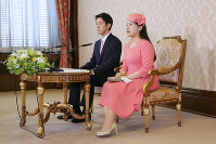 Princess Ayako, right, the youngest daughter of Emperor Akihito's late cousin Prince Takamado and her finance Kei Moriya, an employee at major shipping firm Nippon Yusen Kabushiki Kaisha, attend a news conference at the Imperial Household Agency in Tokyo's Chiyoda Ward, after an announcement of their informal engagement on July 2, 2018. (Pool photo)