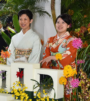 Princess Ayako, right, the youngest daughter of Emperor Akihito's late cousin Prince Takamado, and her mother Princess Hisako, inspect the Japan Grand Prix International Orchid Festival 2018 at Tokyo Dome in Tokyo's Bunkyo Ward, on Feb. 16, 2018. (Pool photo)