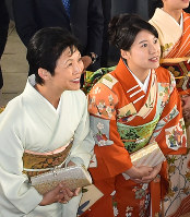 Princess Ayako, right, the youngest daughter of Emperor Akihito's late cousin Prince Takamado, and her mother Princess Hisako inspect the Japan Grand Prix International Orchid Festival 2018 at Tokyo Dome in Tokyo's Bunkyo Ward, on Feb. 16, 2018. (Pool photo)