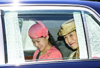 Princess Ayako, left, and her mother Princess Hisako leave the Imperial Palace after reporting Princess Ayako's engagement to businessman Kei Moriya, on the morning of July 2, 2018. (Pool photo)