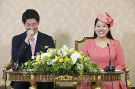 Princess Ayako, right, the youngest daughter of Emperor Akihito's late cousin Prince Takamado, and her fiance Kei Moriya, an employee at major shipping firm Nippon Yusen Kabushiki Kaisha, attend a news conference at the Imperial Household Agency in Tokyo's Chiyoda Ward, after an announcement of their informal engagement on July 2, 2018. (Pool photo)