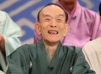 Rakugo storyteller Katsura Utamaru smiles at a press conference after finishing his last appearance in the Japanese comedy TV show