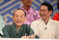 Rakugo storyteller Katsura Utamaru, left, smiles with Shunputei Shota, who was taking over as emcee for the Japanese comedy TV show