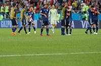 【ベルギー-日本】逆転負けでベスト8を逃してぼう然とする本田(4)ら日本代表の選手たち=ロシア・ロストフナドヌーで2018年7月2日、長谷川直亮撮影