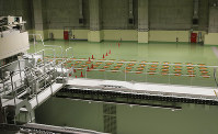 This Nov. 8, 2012 photo shows a floor crane, foreground, and storage pits at the vitrified high-level radioactive waste storage center, a part of the Rokkasho spent nuclear fuel reprocessing plant facilities, run by Japan Nuclear Fuel Ltd. in Rokkasho village in Aomori Prefecture, northern Japan. (AP Photo/Koji Sasahara)