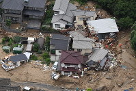 Houses hit by a landslide from heavy rains are seen from a Mainichi Shimbun helicopter, in Hiroshima's Aki Ward, on July 7, 2018. (Mainichi)