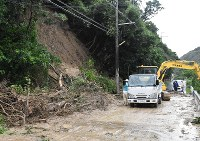 A road is blocked in the Kada district in the city of Wakayama, on July 6, 2018, after landslides. (Mainichi)