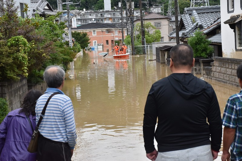 Hundreds of thousands evacuated in Japan as 'historic' rain falls