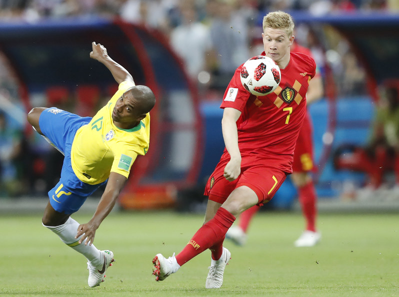 Left And Belgiums Kevin De Bruyne Challenge For The Ball During The Quarterfinal Match Between Brazil And Belgium At The  Soccer World Cup In The