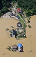 Residences swallowed by flooding due to torrential rains are seen from a Mainichi Shimbun helicopter, in Mihara, Hiroshima Prefecture, on July 9, 2018. (Mainichi)