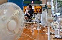Many electric fans are used to try and cool an evacuation center at the municipal Yanominami Elementary School in Aki Ward of Hiroshima city on July 11, 2018. (Mainichi)