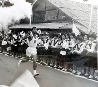 Masao Yabuki runs with the Olympic torch in his hand in Shirakawa, Fukushima Prefecture, in this Sept. 30, 1964 file photo. (Photo courtesy of Masao Yabuki)