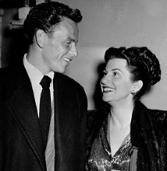 In this Oct. 23, 1946 file photo, singer Frank Sinatra and his wife Nancy smile broadly as they leave a Hollywood nightclub following a surprise meeting. (AP Photo)