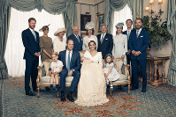 This July 9, 2018, photo provided by the Duke and Duchess of Cambridge shows the official photograph to mark the christening of Prince Louis at Clarence House, following Prince Louis' baptism, in London. Seated, left to right: Prince George, Prince William, the Duke of Cambridge; Prince Louis; Kate, the Duchess of Cambridge; and Princess Charlotte. Standing, left to right: Prince Harry, The Duke of Sussex; Megan, the Duchess of Sussex; Camilla, the Duchess of Cornwall; Prince Charles, Prince of Wales; Carole Middleton, Michael Middleton, Pippa Matthews, James Matthews and James Middleton. (Matt Holyoak/Camera Press/Duke and Duchess of Cambridge via AP)
