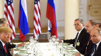 US President of the United States of America Donald Trump, left and Russia's President Vladimir Putin sit opposite each other during their working lunch of the Helsinki Summit with U.S. and Russian delegations in Helsinki, Finland on July 16, 2018. (Heikki Saukkomaa/Lehtikuva via AP)