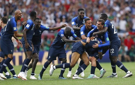French players celebrate at the end of the final match between France and Croatia at the 2018 soccer World Cup in the Luzhniki Stadium in Moscow, Russia, on July 15, 2018. France won 4-2. (AP Photo/Petr David Josek)