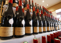 In this Nov. 20, 2014 photo, bottles of Beaujolais Nouveau wine are displayed in a wine store at Issy Les Moulineaux, outskirts of Paris. (AP Photo/Francois Mori)