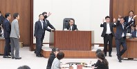 Katsuei Hirasawa, center, chairman of a House of Representatives special committee, puts a bill to amend the Public Offices Election Act to help rectify the disparity in the value of a vote in the House of Councillors, to a vote at the panel on July 17, 2018, as opposition legislators, left, protest the move. (Mainichi)
