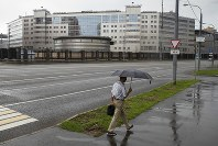 A man walks past the building of the Russian military intelligence service in Moscow, Russia, on July 14, 2018. (AP Photo/Pavel Golovkin)