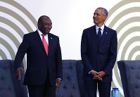 Former US President Barack Obama, right, with President Cyril Ramaphosa, left, as Obama arrives at the Wanderers Stadium in Johannesburg, South Africa, on July 17, 2018 to deliver the 16th Annual Nelson Mandela Lecture. (AP Photo/Themba Hadebe)