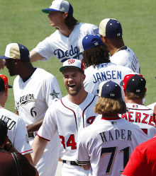 Washington Nationals Bryce Harper, center, smiles as players mingle during a team photo, on July 16, 2018, at Nationals Park, in Washington. (AP Photo/Alex Brandon)