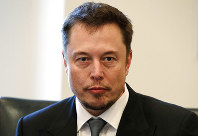 In this Dec. 14, 2016 photo, Tesla CEO Elon Musk listens as President-elect Donald Trump speaks during a meeting with technology industry leaders at Trump Tower in New York. (AP Photo/Evan Vucci)