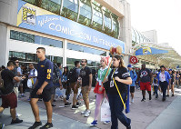 In this July 20, 2017 photo, guests attend the first day of Comic-Con International in San Diego. (Photo by Al Powers/Invision/AP)