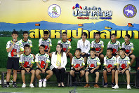 Coach Ekkapol Janthawong, left, speaks on behalf of the 12 boys and himself and their cave rescue during a press conference discussing their ordeal in Chiang Rai, northern Thailand, on July 18, 2018. (AP Photo/Vincent Thian)