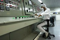 In this Feb. 3, 2007 file photo, an Iranian technician works at the Uranium Conversion Facility just outside the city of Isfahan, Iran, 255 miles (410 kilometers) south of the capital Tehran. (AP Photo/Vahid Salemi, File)