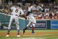 Houston Astros outfielder George Springer (4) celebrates his solo home run in the tenth inning during the Major League Baseball All-star Game, on July 17, 2018 in Washington. (AP Photo/Patrick Semansky)