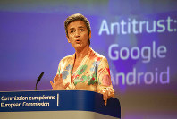EU Commissioner Margrethe Vestager holds a press conference on a Competition Case involving Google Android at the European Commission building, in Brussels on July 18, 2018. (AP Photo/Olivier Matthys)